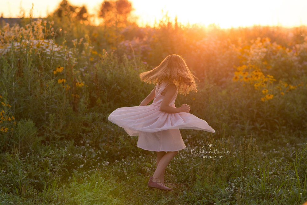 girl spins in a pink dress.jpg