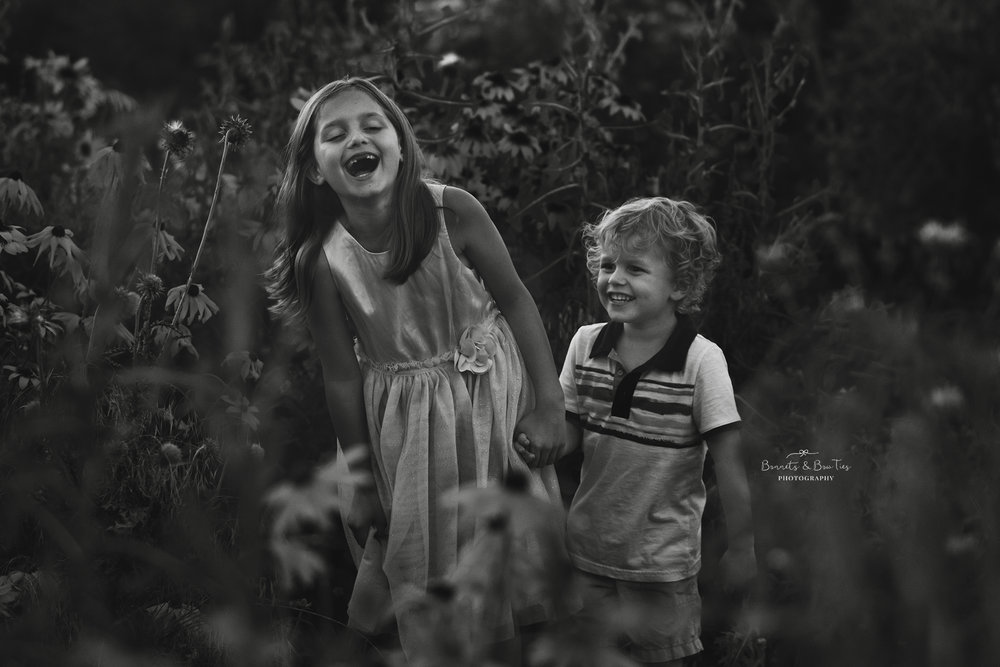 boy and girl laughingbandwhite.jpg