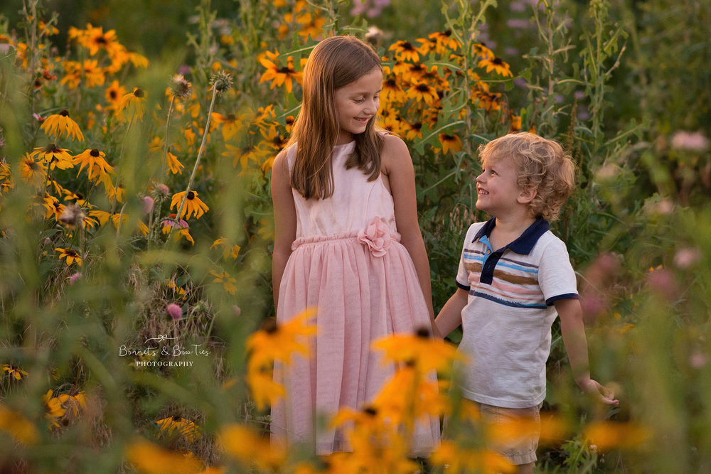sibling shot in a flower field.jpg