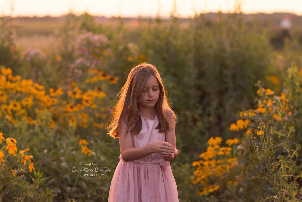girl wearing pink in the flower field.jpg