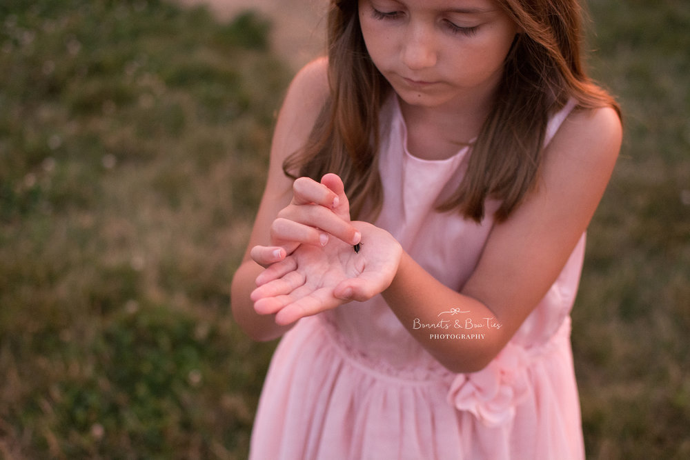 girl wearing pink catching lightning bugs.jpg