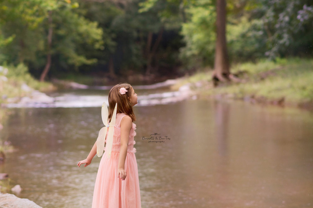 girl wearing pink dress in creek.jpg