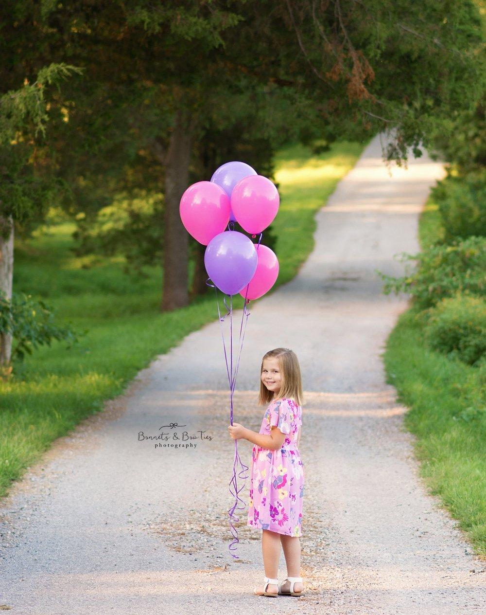 girl holding balloons.jpg