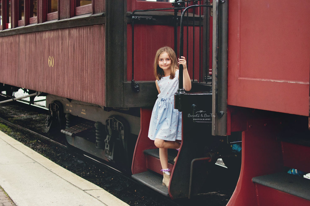 girl posing on train.jpg