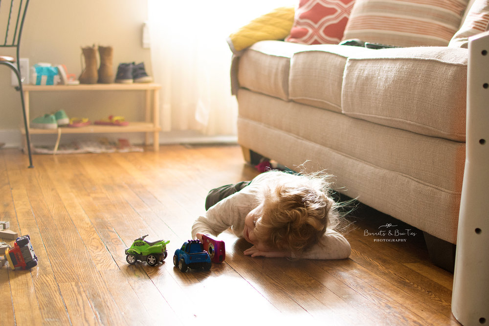 little boy playing on floor