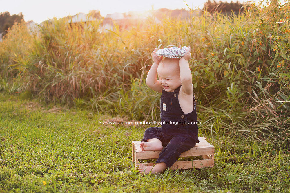 baby in a wheat field