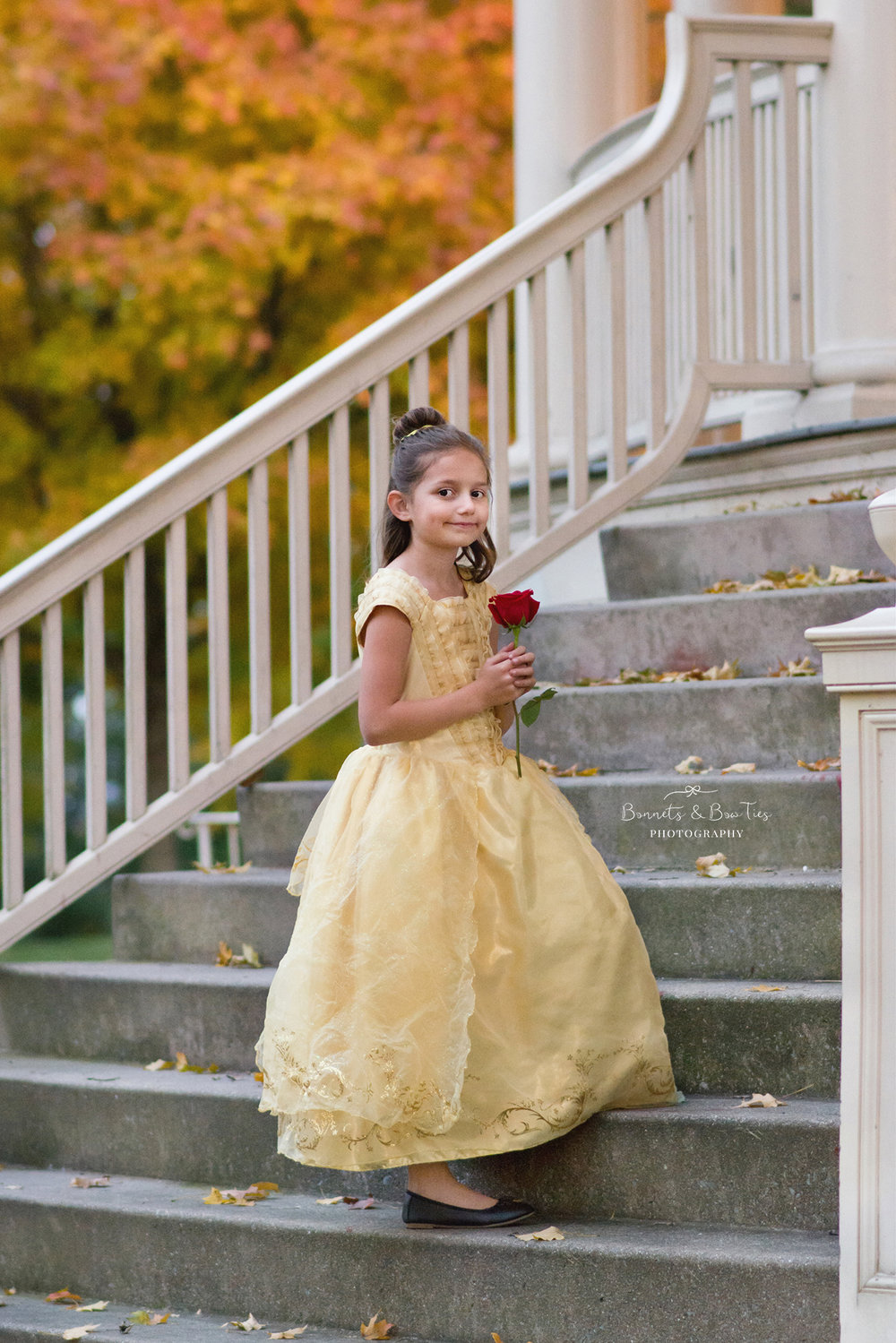 girl in yelloe Belle dress.jpg