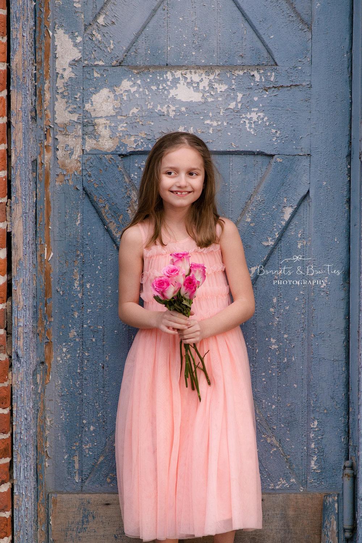 girl wearing pink holding roses.jpg