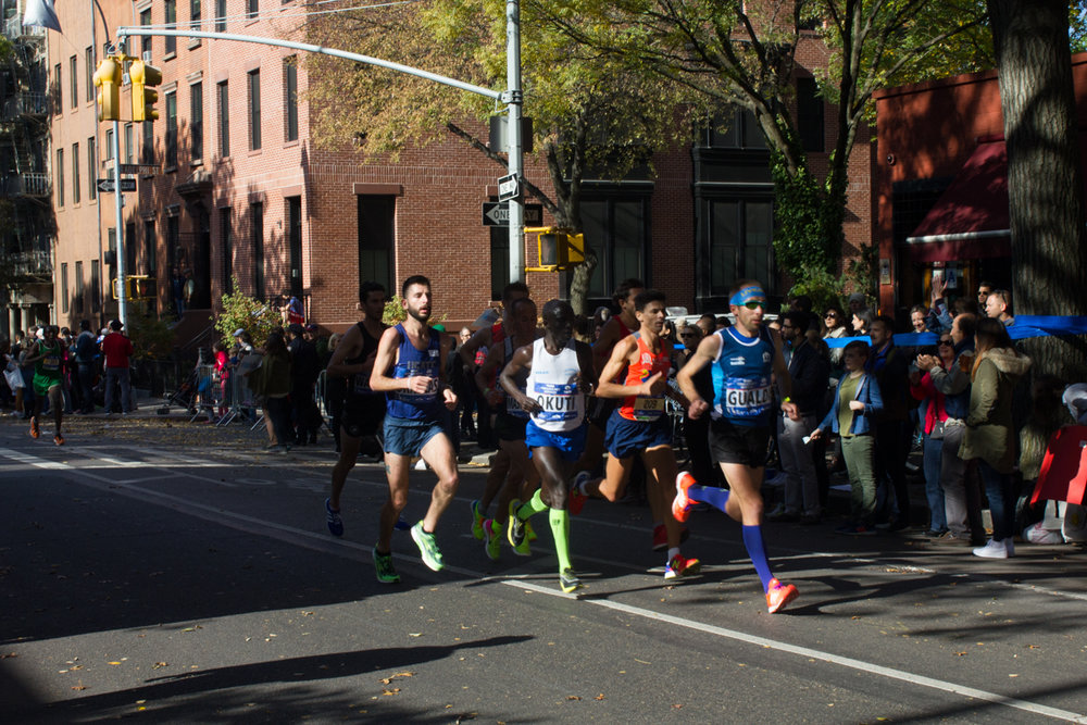 A group runs down Lafayette Street in Brooklyn.
