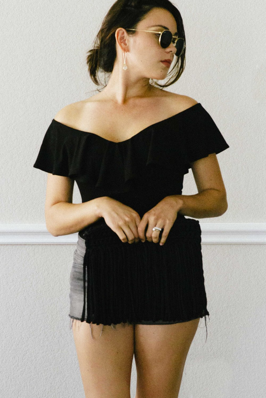 black-ruffle-bodysuit-denim-shorts-mozart-shiplap