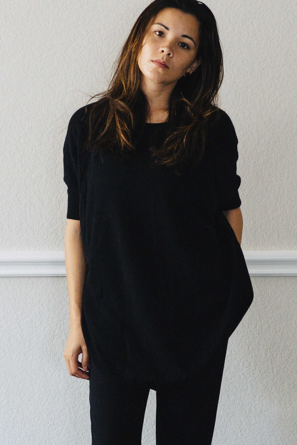 Woman in Black. A basic black capsule wardrobe outfit.