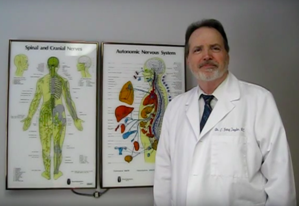 Dr. C. Gary Taylor, chiropractor and holistic care specialist, stands in the examination room of Advanced Wellness, his Columbus, Georgia, clinic