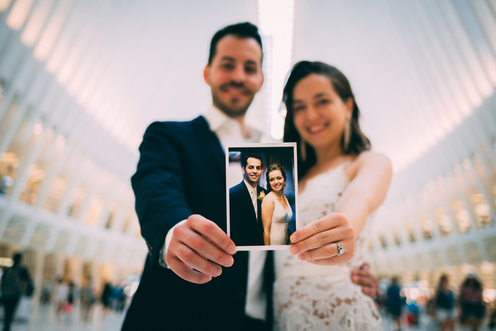 Holding our original wedding photo