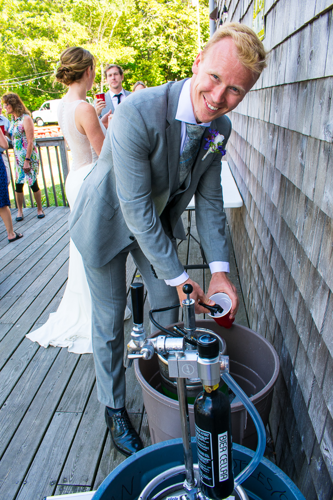 The groomsmen tapped the kegs