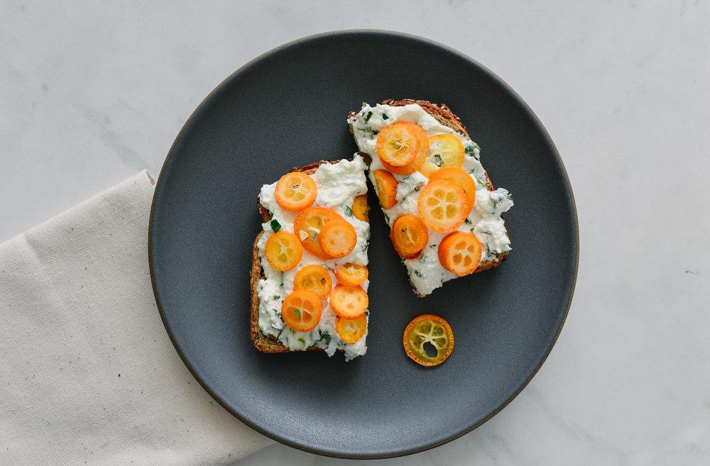 Kumquats on ricotta toast -