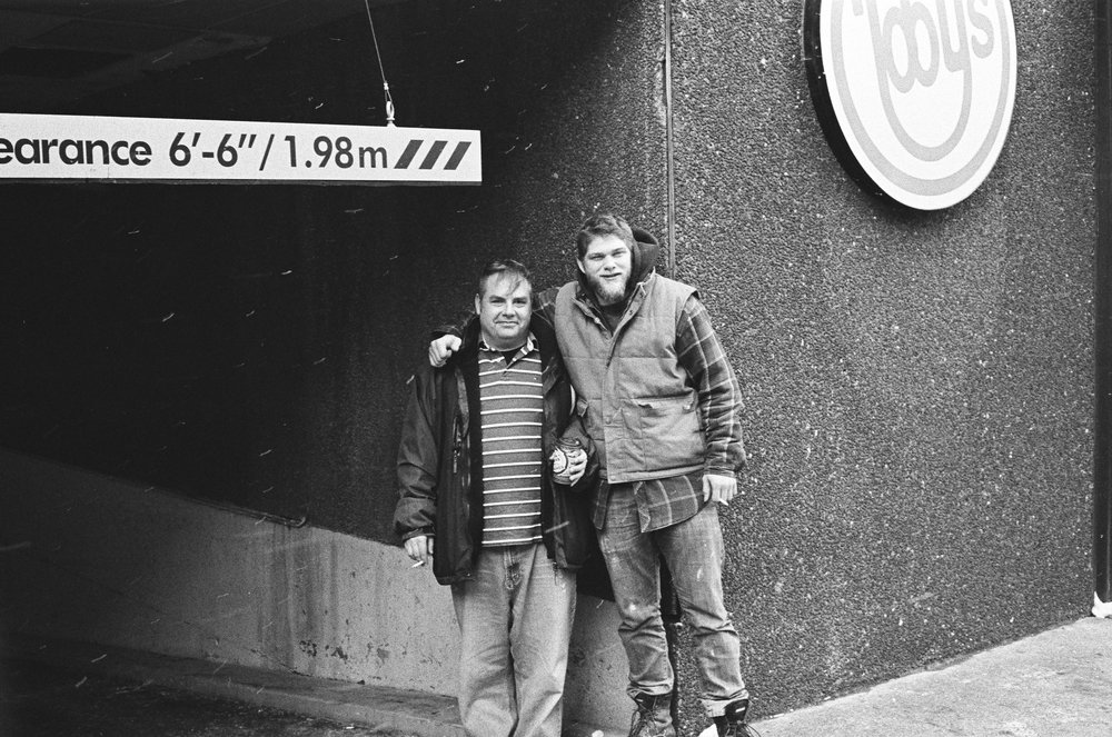 A cold miserable day in Downtown was not enough to make these blokes unhappy.    Olympus SP Rangefinder Tri-X developed in Blazinal for 13 minutes.