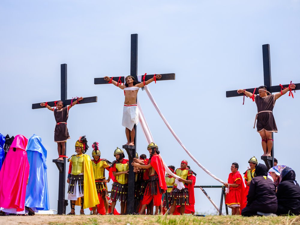 Ruben Enaje (CENTRE), a sign painter who began his yearly rite after surviving a fall from a building.  This year was the 32nd time he has been crucified.  Fuji GFX, 110mm.
