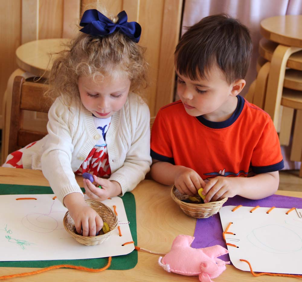 Drawing and crafts give children a chance to explore colors and different natural materials, such as real beeswax crayons and wool yarn.