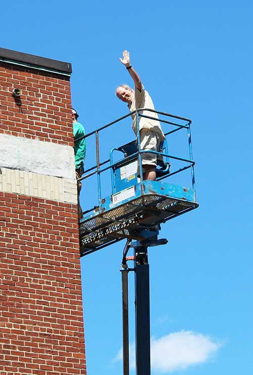 Hello up there! Fortunately Mr. Menz is not afraid of heights. Here he is overseeing the resealing of the Adams building's brick façade. The Adams building also got new, energy-efficient exterior LED lighting.