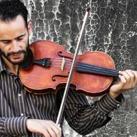 Ramzi Aburedwan, of the Dal'ouna Ensemble, playing violin
