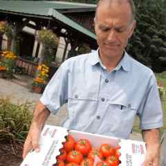 Farmers to You founder Greg Georgaklis holding fresh produce from VT family farms