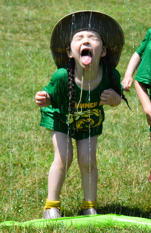 On a hot day, there's nothing better than a big green field and a sprinkler to run through (and wet your whistle!).