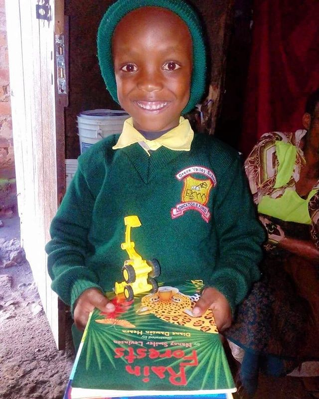 Musa showing off his new toy truck and books from his sponsor! Looking like a cutie in his Green Valley Uniform!! #educate #sponsor #support #happy #empower #school #love #arusha #tanzania @educating_tanzania_foundation_