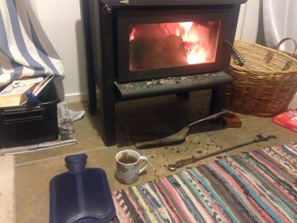 New Zealand winter starter kit:  Hot water bottle, cup of tea, wood burning stove.