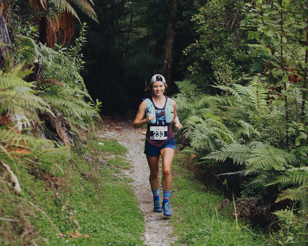 Bloody knees and still smiling. Smile didn't last past 20km though.