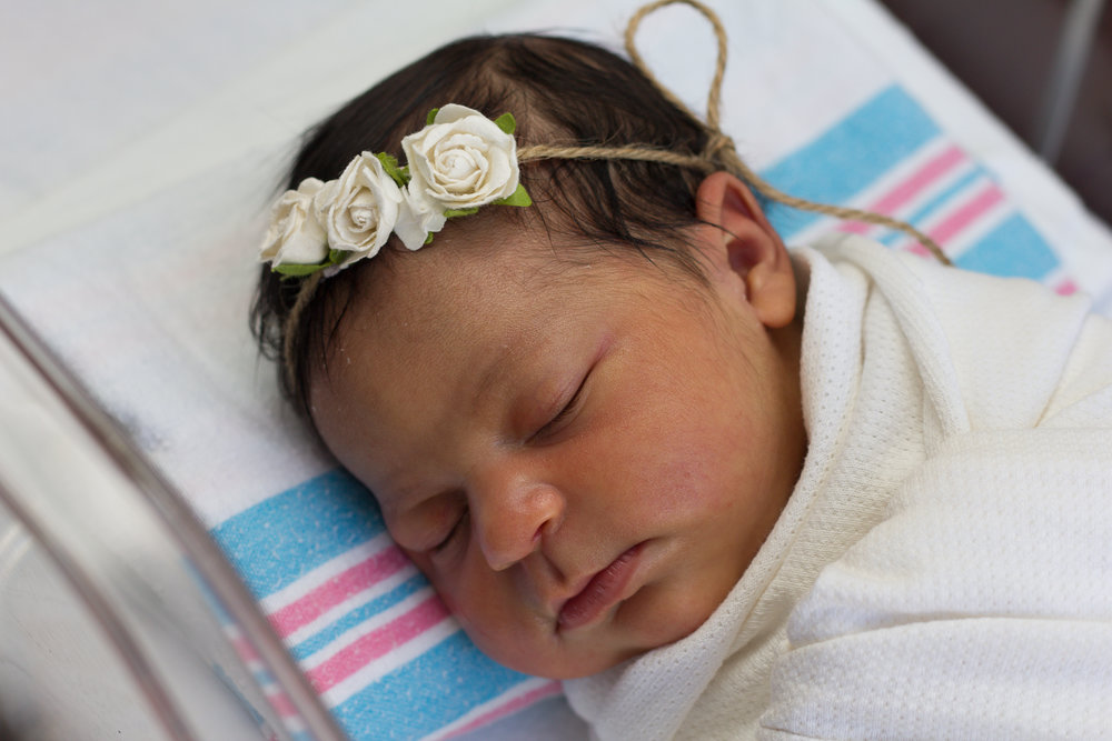 Rex-hospital-newborn-photography-fresh-48-Rex-hospital-newborn-photographer-baby-girl-with-flower-headband