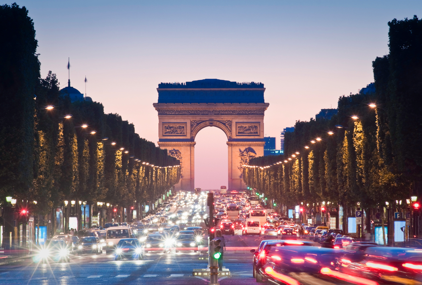 Traffic on road leading to arc de triomphe in paris