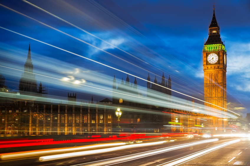 View of Big Ben from westminster bridge with lights from passing traffic