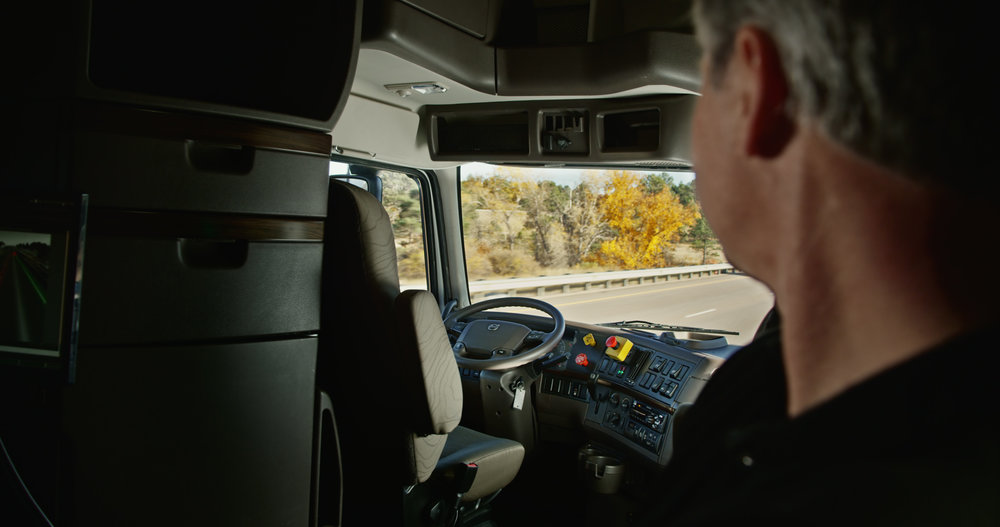 Otto driverless truck cabin with driver looking on