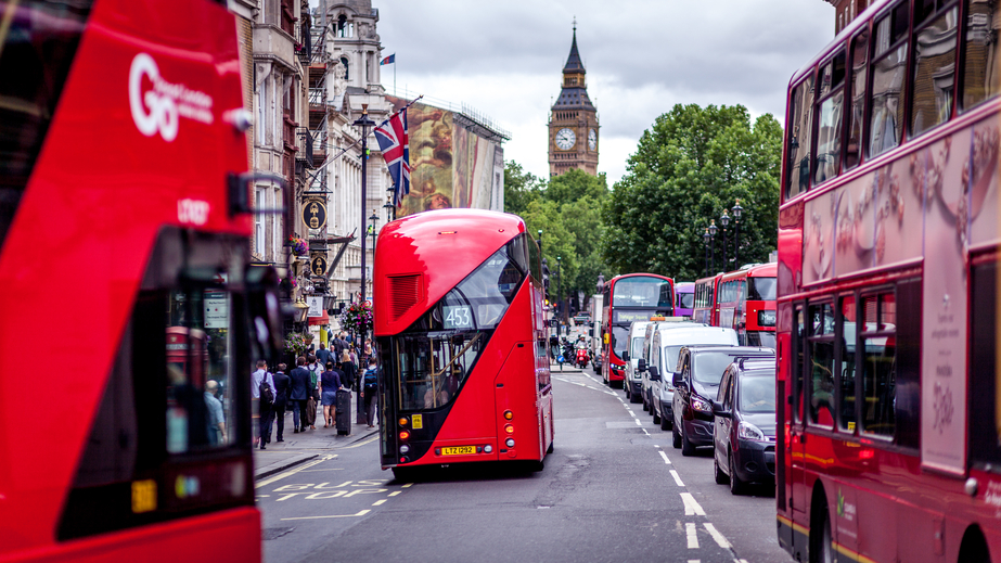 Traffic Jam in london with red double decker buses and big ben in distance