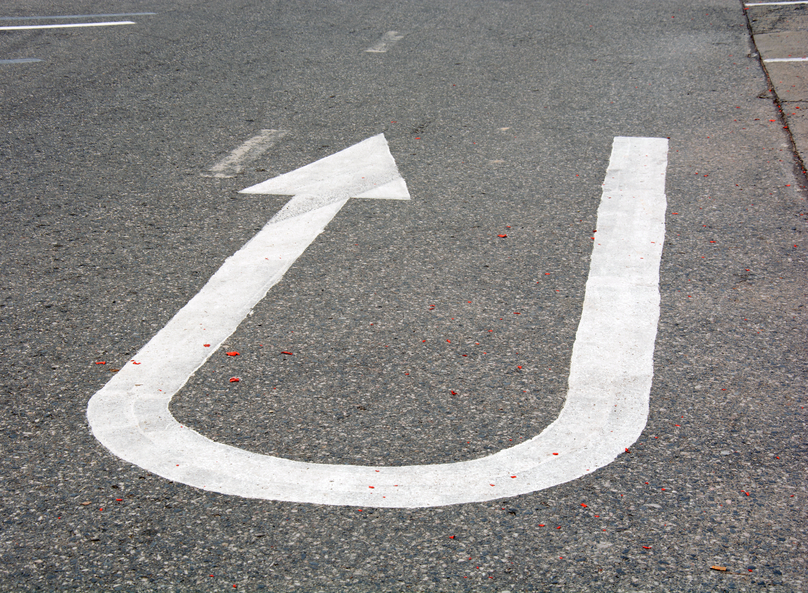 Arrow on tarmac depicting turn in road
