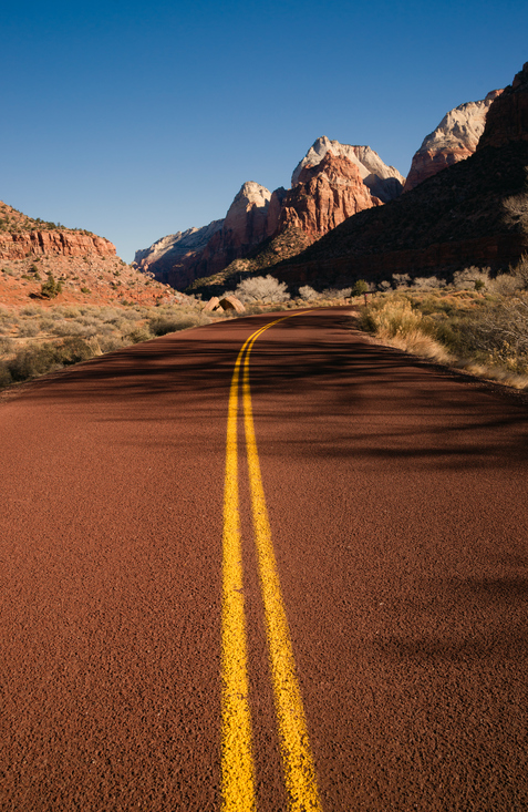 Red asphalt roadway Redrock Canyon Utah Backroads