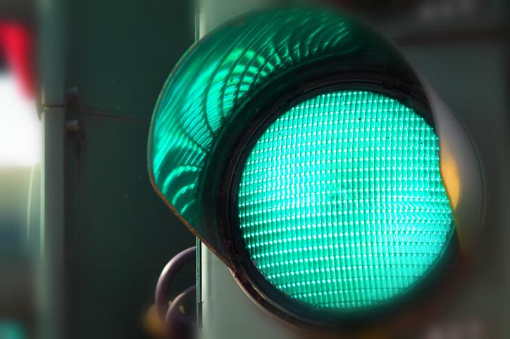 green-color-on-the-traffic-light-gm831038750-135084883.jpg