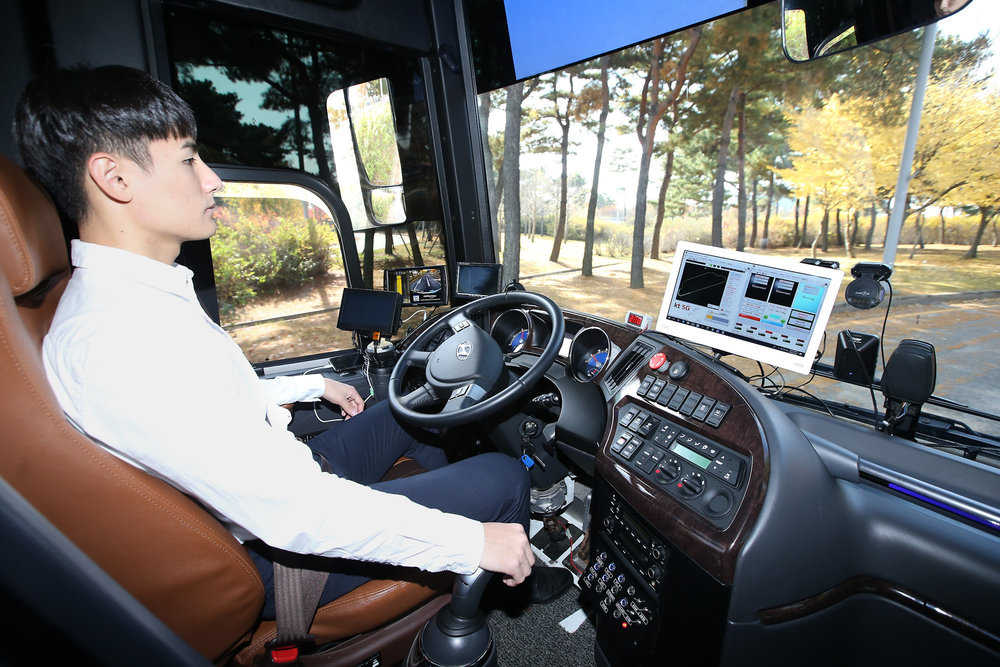 A KT employee is photographed while checking signals delivered to the company's self-driving bus during its test run at Incheon International Airport on November 11. (Image courtesy of KT Corp.)