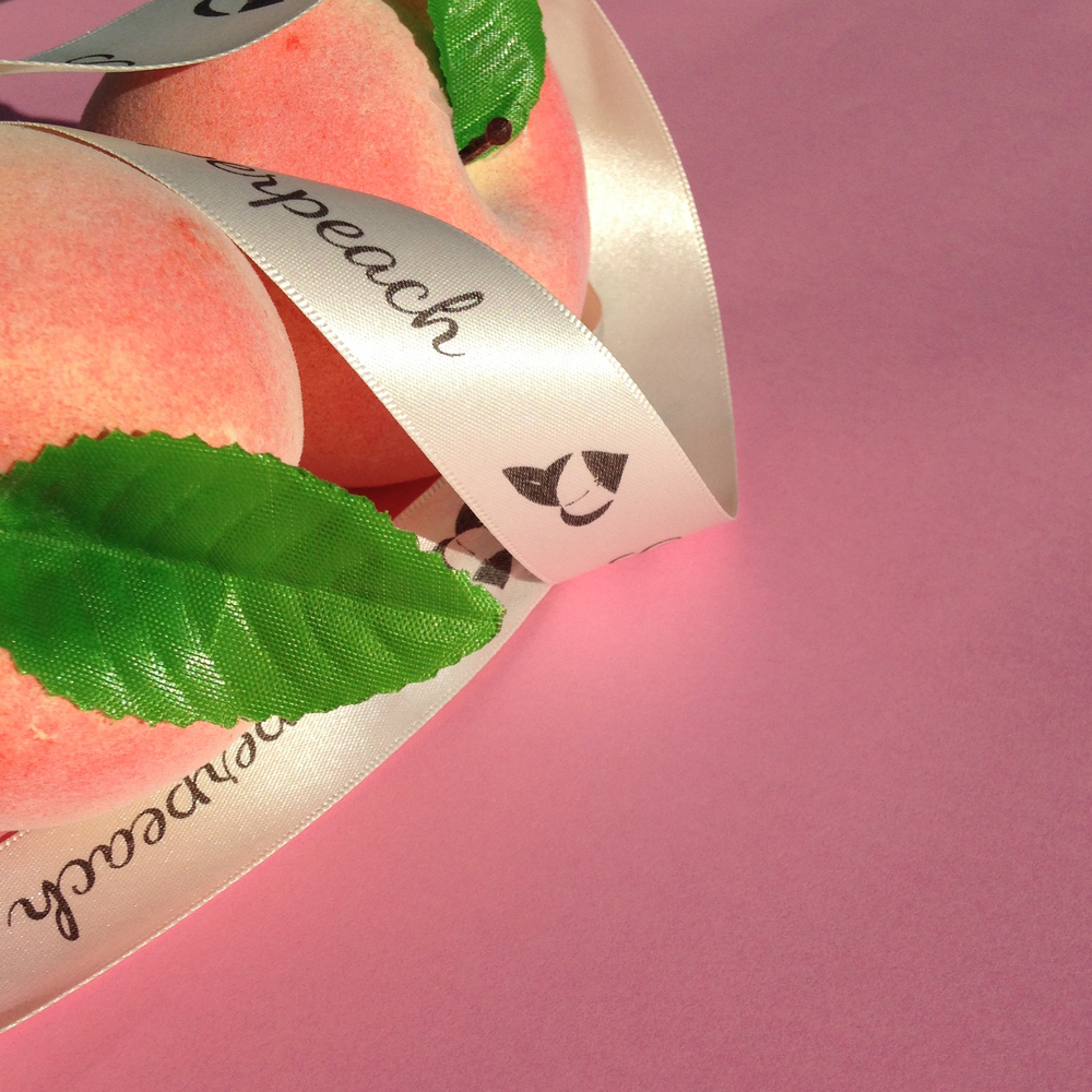 Superpeach peaches and giftwrapping ribbon