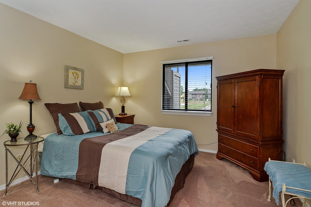 14_1135SuncrestCir_14_MasterBedroom_HiRes.jpg