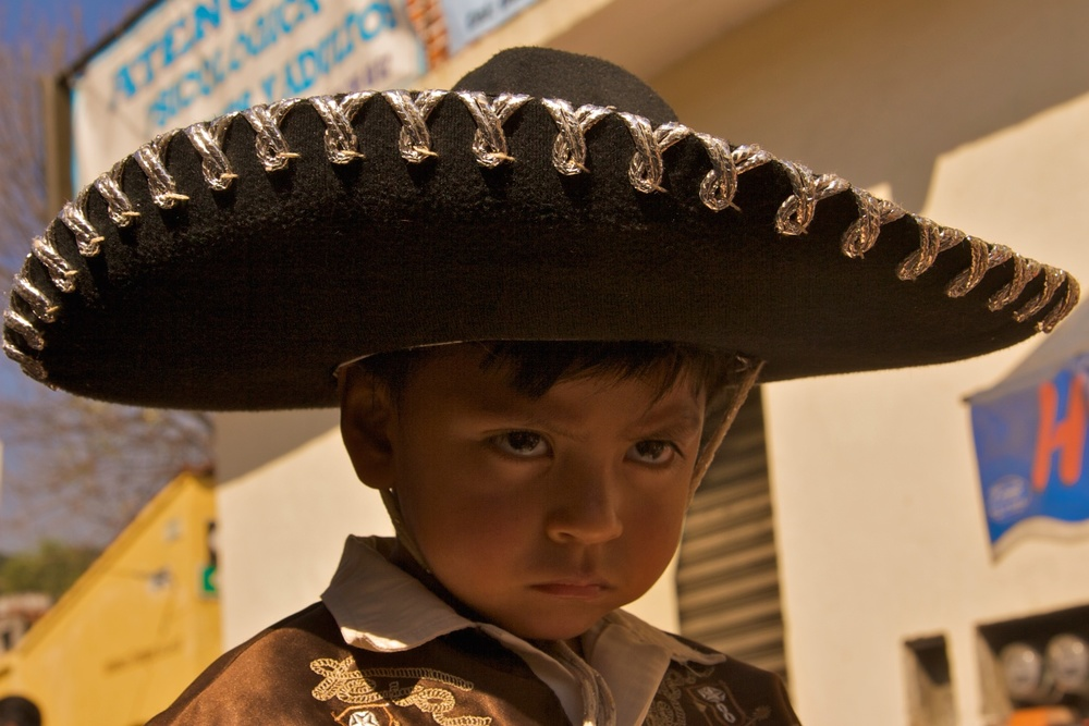 Reluctant participant on Revolution Day, Tepoztlán, Mexico.