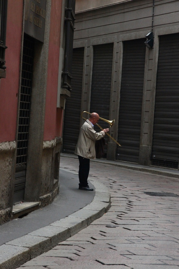 Playing a lonely tune for a non-existant audience. Rome, Italy.
