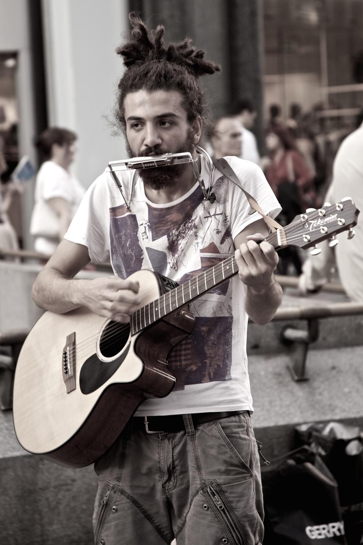 Strumming in Bob Dylan's footsteps. Vienna, Austria.