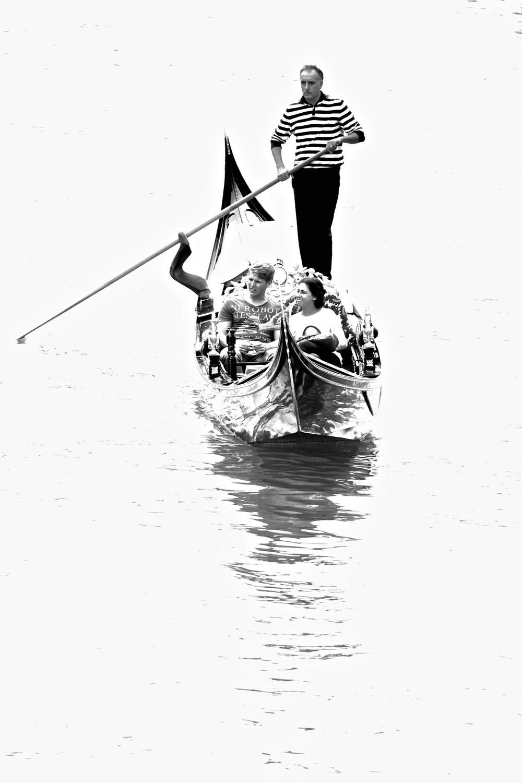 Riding peaceful Venetian waters.