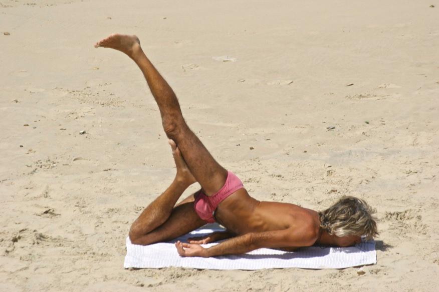 Yoga session on the beach. Tel Aviv, Israel