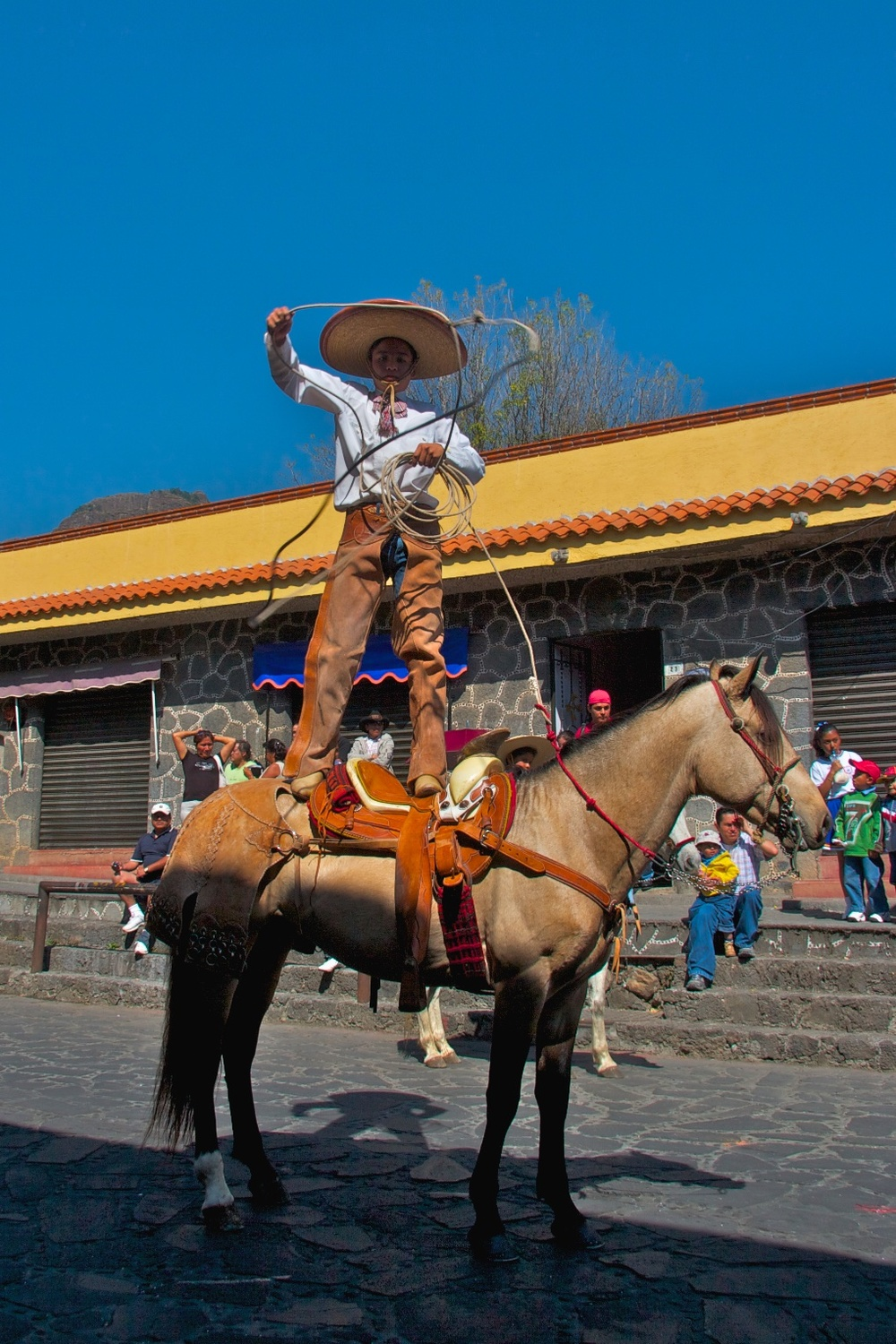 Horseback charro on Revolution day. Tepoztlán, Mexico
