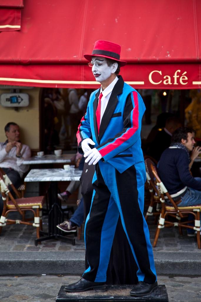 A sad figure on the streets of Paris.
