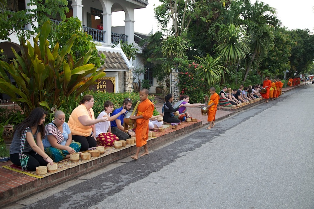 Ritual offering to novice monks. Luang Prabang, Laos