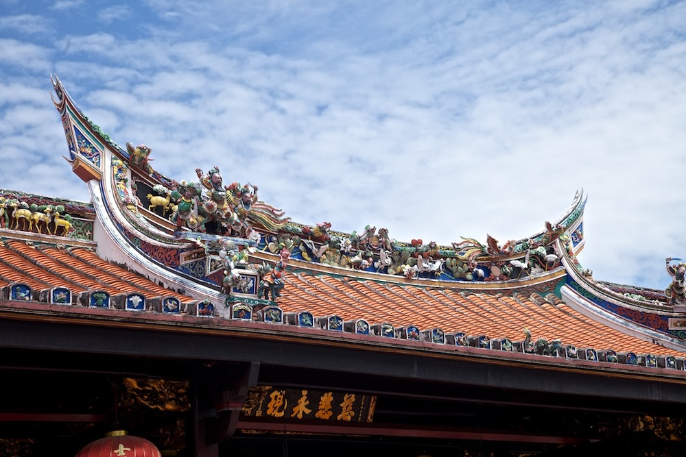 Religious roof adornment in Malacca, Malaysia.