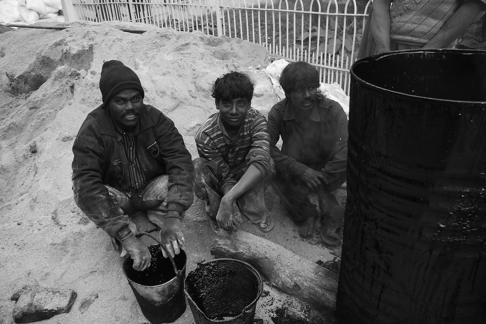 Asphalt road workers. Darjeeling, India.